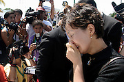 14 SEPTEMBER 2003 - CANCUN, QUINTANA ROO, MEXICO:  A daughter of Lee Kyung-hae weeps at an alter for her father during a memorial service Sunday for her father, a Korean farm activist who publicly committed suicide Wednesday in Cancun to protest World Trade Organization agricultural policies, has been built where he died in a park in Cancun. Thousands of protestors opposed to the World Trade Organization and globalization have come to Cancun to protest the WTO meetings taking place in the hotel zone. Mexican police restricted most of the anti-globalization protestors to downtown Cancun, about five miles from the convention center.  PHOTO BY JACK KURTZ