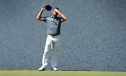 Gary Woodland stretches while waiting to putt on the 14th green during first round action of the PGA Championship at Quail Hollow Club Thursday, Aug. 10, 2017 in Charlotte, N.C. (Photo by Jeff Siner/Charlotte Observer/TNS/Sipa USA)  *** Please Use Credit from Credit Field ***
