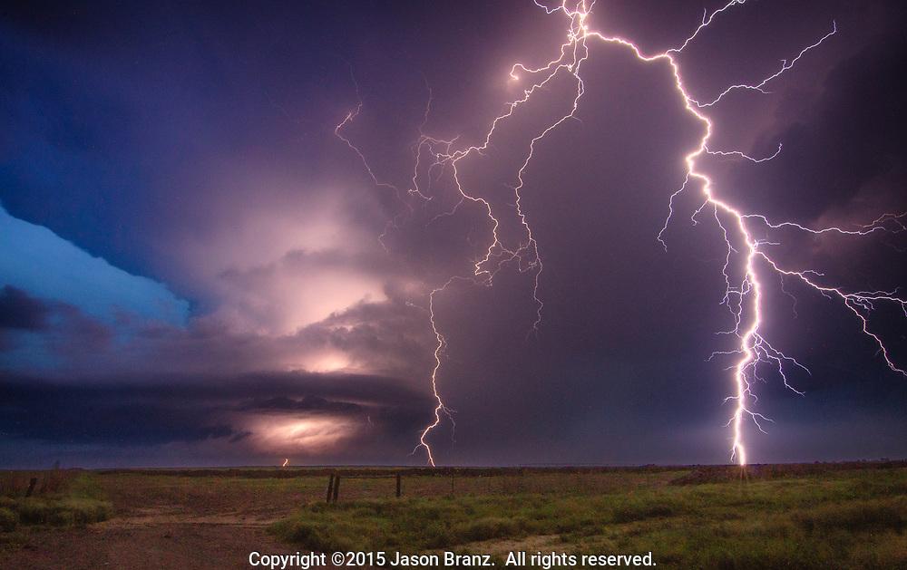Multiple lightning strikes from a supercell thunderstorm in western Kansas.