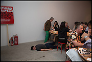 SAM KENNEDY ( ON FLOOR ) PERFORMING A PIECE OF WORK BY LEAH CAPALDI, ( SEATED )  Matt's Gallery 35th birthday fundraising supper.  42-44 Copperfield Road, London E3 4RR. 12 June 2014.