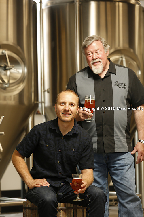 SHOT 7/22/16 2:16:59 PM - Bruz Beers co-founders Charlie Gottenkieny and Ryan Evans inside the new brewery near 67th Avenue and Pecos in Denver, Co. Bruz Beers is Denver's artisanal Belgian-style brewery, featuring a full line of traditional and Belgian-inspired brews, hand-crafted in small batches. Includes images of Evan's dog 'Cooper' as well who serves as the brewery dog. (Photo by Marc Piscotty / © 2016)