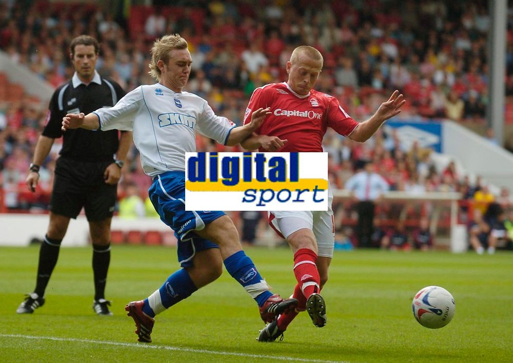 Photo: Leigh Quinnell.<br /> Nottingham Forest v Brighton & Hove Albion. Coca Cola League 1. 19/08/2006. Brightons Tony Stokes clashes with Nottingham Forests Sammy Clingan.