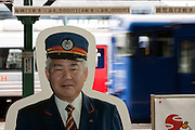 A cardboard cut out of a station guard stands by a ticket gate at a train station near Nagasaki, Japan Wednesday January 6th 2010