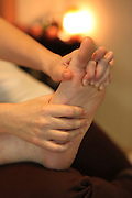 reflexology Masseuse treats a patient