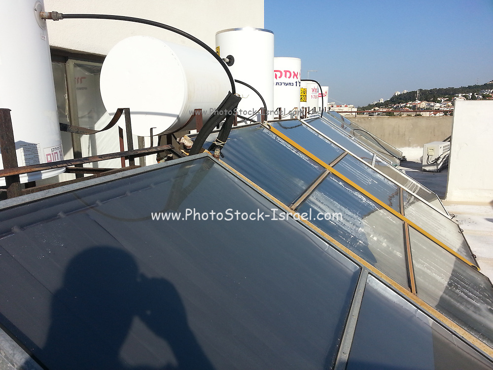 Rooftop solar powered water heaters. Photographed in Israel