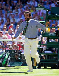 03.07.2014, All England Lawn Tennis Club, London, ENG, WTA Tour, Wimbledon, Tag 10, im Bild Chair umpire Kader Nouni halts the game in the first set tie-break as he leaps from his seat to call for medical assistant for a spectator who was taken ill during the Ladies' Singles Semi-Final match on day ten // during day 10 of the Wimbledon Championships at the All England Lawn Tennis Club in London, Great Britain on 2014/07/03. EXPA Pictures © 2014, PhotoCredit: EXPA/ Propagandaphoto/ David Rawcliffe<br /> <br /> *****ATTENTION - OUT of ENG, GBR*****