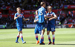 Stoke City's Peter Crouch (second right) celebrates scoring his side's second goal of the game with team-mates Xherdan Shaqiri and Lasse Sorenson (right) during the Premier League match at the Liberty Stadium, Swansea.