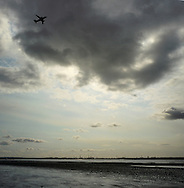 A passenger aircraft taking off from Liverpool airport and flying over the Stanlow oil refinery at Ellesmere Port. The Mersey is a river in north west England which stretches for 70 miles (112 km) from Stockport, Greater Manchester, ending at Liverpool Bay, Merseyside. For centuries, it formed part of the ancient county divide between Lancashire and Cheshire.