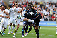 Swansea city's Angel Rangel © blocks a shot from West Ham's Kevin Nolan (4). Barclays Premier league, Swansea city  v West Ham Utd at the Liberty Stadium in Swansea, South Wales  on Saturday 25th August 2012. pic by Andrew Orchard, Andrew Orchard sports photography,