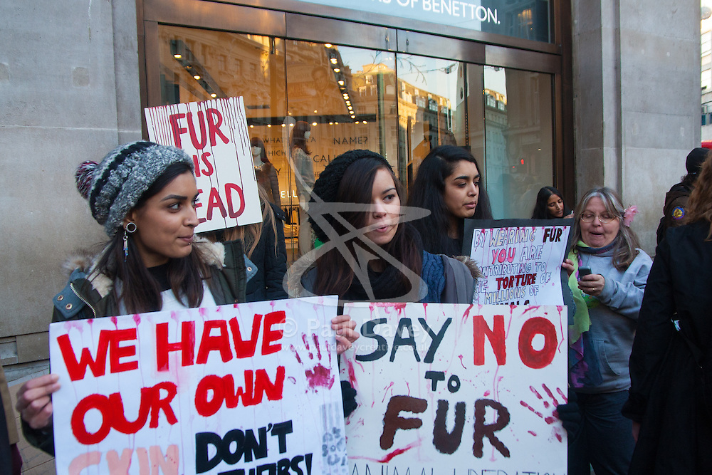 London, December 6th 2014. Tens of thousands throng the streets of London as shoppers take advantages of ongoing deals and discounts offered by retailers in the run-up to Christmas. PICTURED: Protesters demonstrate against the use of rabbit fur by Benetton.
