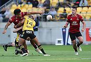 Crusaders Leicester Fainga'anuku offloads to Will Jordan. Super Rugby Aotearoa. Hurricanes v Crusaders, Sky Stadium, Wellington. Sunday 11th April 2021. Copyright photo: Grant Down / www.photosport.nz