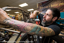 Xavier Muriel, the drummer for the band Buckcherry, put his sticks down to live and work in Billy Lane's shop to help with preparations for the race scheduled on the Saturday of Bike Week. FL. USA. Tuesday, March 14, 2017. Photography ©2017 Michael Lichter.
