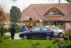 © Licensed to London News Pictures. 31/12/2013, Bosham, UK.  Forensic Experts at the scene where a murder enquiry has been launched after a 55-year-old woman was found dead with serious head injuries at a house at Smuggler's Lane, in Bosham, near Chichester, West Sussex, on Monday morning. Photo Credit: Rob Arnold/LNP