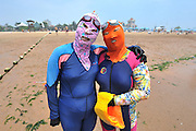 QINGDAO, CHINA - JULY 05: <br /> <br /> A woman wearing facekini is seen at beach on July 5, 2016 in Qingdao, Shandong Province of China. People wear the facekinis to protect themselves from sun\'s rays, jellyfish and algae.<br /> ©Excluisvepix Media