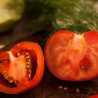 One factor in transgenetic tomatos is increase in the starch levels and a concomitant reduction in the water content yielding a higher dry weight and cost savings in the processing procedure. The tomato is less seedy and has little or no juice, while the natural tomato as shown on the left is juicy and full of flavor.