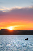 Fishing from boat on  Soda Lake at sunset, Wyoming