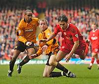 Photo. Jed Wee.<br /> Liverpool v Wolverhampton Wanderers, FA Barclaycard Premiership, Anfield, Liverpool. 20/03/2004.<br /> Wolves' Mark Clyde (C) sends Liverpool's Milan Baros (R) flying through the air as Paul Ince looks on.