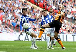 Michael Dawson of Hull City has a shot on goal which hits Kieran Lee of Sheffield Wednesday on the hand - Mandatory by-line: Robbie Stephenson/JMP - 28/05/2016 - FOOTBALL - Wembley Stadium - London, England - Hull City v Sheffield Wednesday - Sky Bet Championship Play-off Final