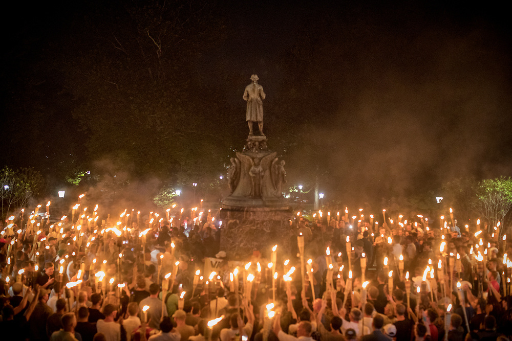CHARLOTTESVILLE, VA. USA. August 11th 2017. White nationalists rallied at a statue of Thomas Jefferson on the grounds of the University of Virginia in Charlottesville on Friday. Student protesters resisting the rally stood with a banner at the foot of the statue.<br /> <br /> The rally occurred amidst the backdrop of controversy generated by the removal of Confederate monuments throughout the country in response to the Charleston church shooting in 2015. The event turned violent after protesters clashed with counter-protesters, which combined with the subsequent vehicle-ramming attack left over 30 injured