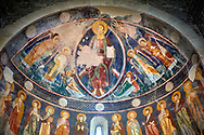 Interior Byzantine Romanesque style Christian frescoes of the central apse with Christ Pantocrator (in majesty) in a maodorla, Santissima Trinita di Saccargia, consecrated 1116 AD, Codrongianos, Sardinia. .<br /> <br /> Visit our SARDINIA HISTORIC PLACXES PHOTO COLLECTIONS for more photos to download or buy as wall art prints https://funkystock.photoshelter.com/gallery-collection/Pictures-Images-of-Sardinia-Sardinia-Historical-Travel-Sites/C0000MEM.pIAwgvM <br /> .<br /> Visit our MEDIEVAL PHOTO COLLECTIONS for more   photos  to download or buy as prints https://funkystock.photoshelter.com/gallery-collection/Medieval-Middle-Ages-Historic-Places-Arcaeological-Sites-Pictures-Images-of/C0000B5ZA54_WD0s