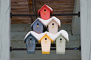 Closeup of colorful birdhouses covered with snow