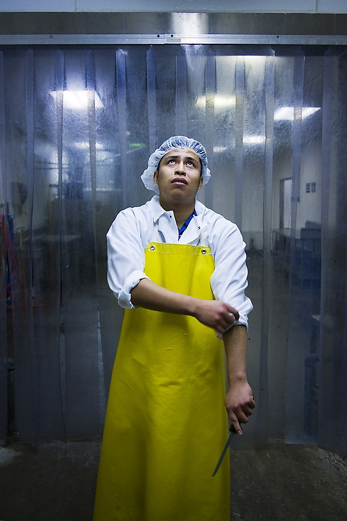 Eduardo Leon dresses for work at Hudson Valley Foie Gras in Ferndale, New York on October 12, 2008. Leon, who immigrated from Puebla state, Mexico to upstate New York to join his parents and siblings, works every day at the factory to support his wife who stays home while expecting a child.