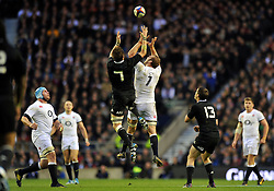 Richie McCaw (New Zealand) and Chris Robshaw (England) compete for the ball in the air - Photo mandatory by-line: Patrick Khachfe/JMP - Tel: Mobile: 07966 386802 16/11/2013 - SPORT - RUGBY UNION -  Twickenham Stadium, London - England v New Zealand - QBE Autumn Internationals.