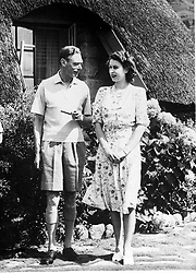 Embargoed to 2100 Friday May 08 File photo dated 21/04/47 of King George VI relaxing with his daughter Princess Elizabeth during a visit to Natal National Park in South Africa. The Queen reflected on her father's VE Day message in her own address which was broadcast at exactly the same moment three-quarters of a century apart.