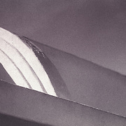 Closeup detail of curved roof architectural feature on a one-story, 1950's era apartment in San Diego.