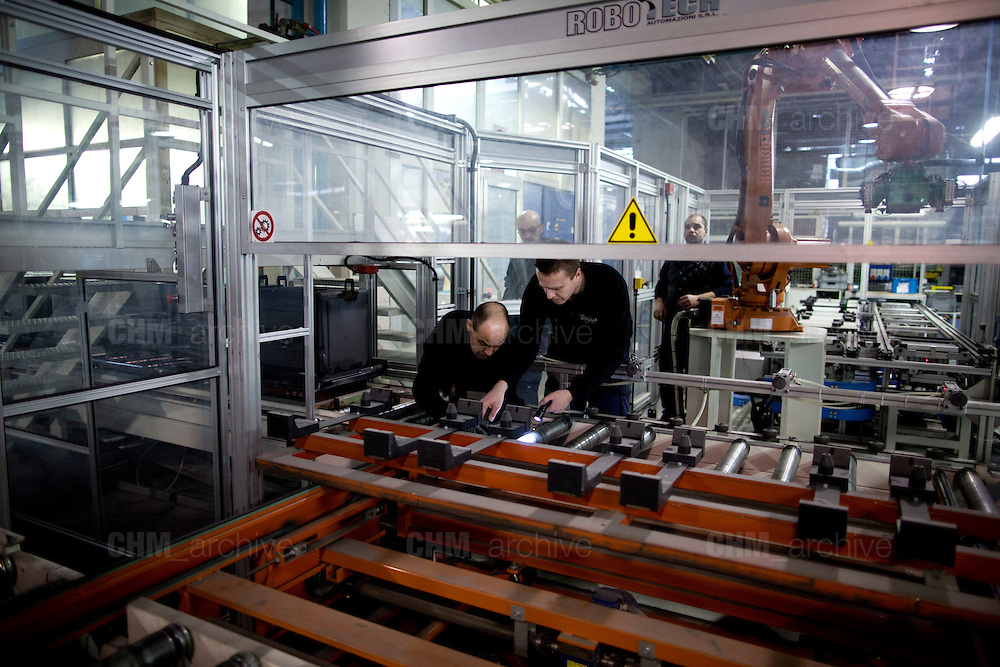 Men working in the factory of Whirlpool Corporations. Cassinetta di Biandronno, Varese, Milan, Italy, 30 january 2014. Guido Montani / OneShot