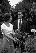 28/6/1964<br /> 6/28/1964<br /> 28 June 1964<br /> <br /> Mr. Nicholas Ballantine winner of sweeps on Orwell St.  and his Mother Mrs Cherrie Ballantine standing in the garden of Mr. McConnock