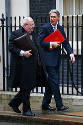 © Licensed to London News Pictures. 02/12/2014. LONDON, UK. Communities Secretary Eric Pickles and Foreign Secretary Philip Hammond attending to a cabinet meeting on Downing Street on Tuesday, 2 December 2014. Photo credit: Tolga Akmen/LNP