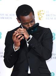 Micheal Ward with his EE Rising Star Award at the 73rd British Academy Film Awards held at the Royal Albert Hall, London.. Photo credit should read: Doug Peters/EMPICS