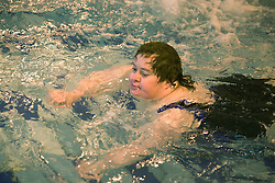 Day service users with learning disability learning to swim at the local swimming pool,