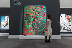 "© Licensed to London News Pictures. 01/10/2018. LONDON, UK. A visitor views (C) ""Afromantics"", 2000-2002, by Chris Ofili (Est. GBP1 - 1.5m). Preview of artworks in Sotheby's Frieze sales at Sotheby's New Bond Street.  The auction will take place 5 October during Frieze and Frieze Masters – the world's most vibrant Contemporary and Modern art fairs.  Photo credit: Stephen Chung/LNP"