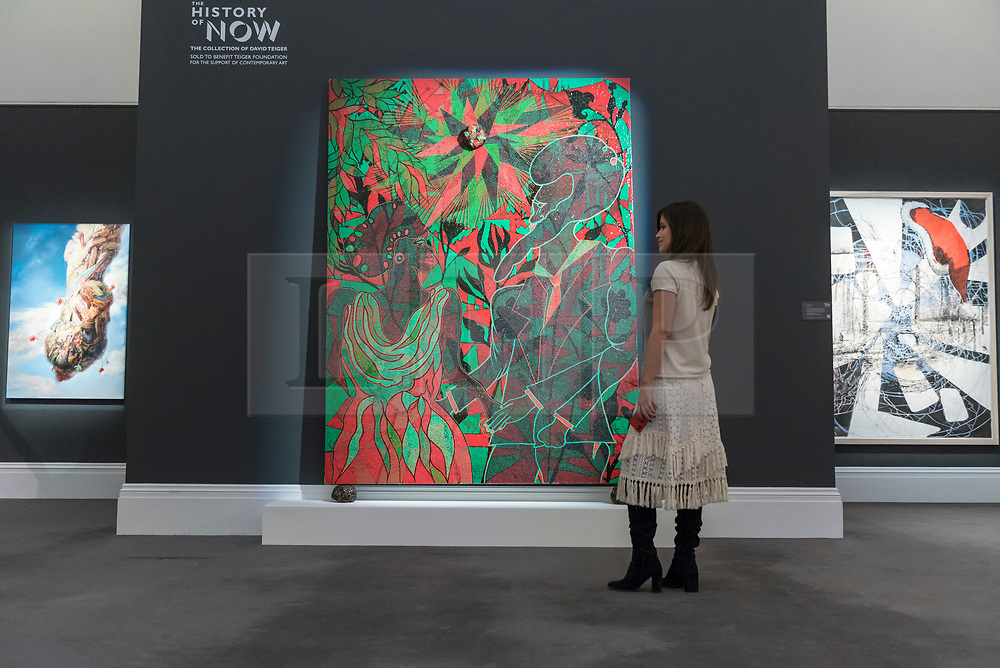 """© Licensed to London News Pictures. 01/10/2018. LONDON, UK. A visitor views (C) """"Afromantics"""", 2000-2002, by Chris Ofili (Est. GBP1 - 1.5m). Preview of artworks in Sotheby's Frieze sales at Sotheby's New Bond Street.  The auction will take place 5 October during Frieze and Frieze Masters – the world's most vibrant Contemporary and Modern art fairs.  Photo credit: Stephen Chung/LNP"""