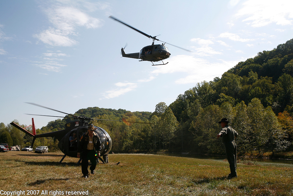 """A Vietnam era UH-1D Huey helicopter, commonly called a """"slick"""" during the Vietnam War, flies during the Knob Creek machine gun shoot in Kentucky."""