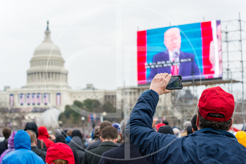 Washington DC, United States - A Trump supporter records events on a mobile device during the 2017 inauguration ceremony for Donald J. Trump.