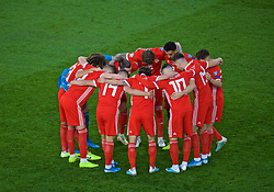 CARDIFF, WALES - Friday, September 6, 2019: Wales players form a pre-match huddle before the UEFA Euro 2020 Qualifying Group E match between Wales and Azerbaijan at the Cardiff City Stadium. (Pic by Paul Greenwood/Propaganda)