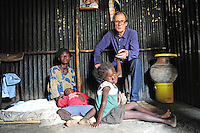 BILL WITH CAROLINE AND HER FAMILY; KAPPY(PICTURED); FIDEL AND GABRIEL. SHAURIYAKO SLUMS, EXTREAM POVERTY HIV