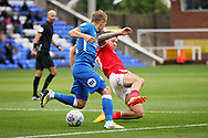 Barnsley midfielder George Moncur (10)  attempts a tackle during the EFL Sky Bet League 1 match between Peterborough United and Barnsley at The Abax Stadium, Peterborough, England on 6 October 2018.