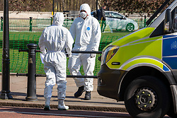 © Licensed to London News Pictures. 16/03/2020. London, UK. Ambulance medics in protective clothing outside Buckingham Palace today as they assist police who were talking to man. Government ministers warn that the over 70s could face self-isolation for weeks as the Coronavirus disease pandemic continues . Photo credit: Alex Lentati/LNP