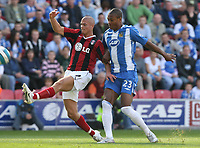 Photo: Sportsbeat Images.<br />Wigan Athletic v Fulham. The FA Barclays Premiership. 15/09/2007.<br />Fulham's Paul Konchesky (L) clears the ball from the feet of  Wigan's Marcus Bent