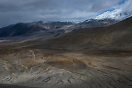 The Valley of Ten Thousand Smokes from the ridge line of Baked Mountain. A ridge of Mt Griggs can be seen in the background. Katmai National Park & Preserve, Alaska.