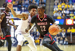 Dec 14, 2019; Morgantown, WV, USA; Nicholls State Colonels guard Dexter McClanahan (22) drives against West Virginia Mountaineers guard Miles McBride (4) during the first half at WVU Coliseum. Mandatory Credit: Ben Queen-USA TODAY Sports