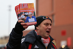 10th December 2017 - Premier League - Liverpool v Everton - A fanzine seller promotes a copy of 'Red All Over The Land', with Prime Minister Theresa May on the front cover - Photo: Simon Stacpoole / Offside.