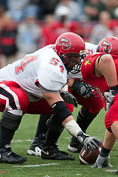 08 OCT 2005 WKU Hilltopper center Erik Losey gets set. The Illinois State University Redbirds roped and tied the Western Kentucky University Hilltoppers in regulation but loosened the noose in Overtime as the Hilltoppers take the honors with a 37 - 24 Victory in Gateway Conference action at Hancock Stadium on Illinois State's campus in Normal IL.