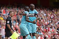 Cheikhou Kouyate of West Ham United celebrates scoring his first goal his teams first goal of the game to make it 0-1 with teammate Angelo Ogbonna Obinze of West Ham United. Barclays Premier League, Arsenal v West Ham Utd at the Emirates Stadium in London on Sunday 9th August 2015.<br /> pic by John Patrick Fletcher, Andrew Orchard sports photography.