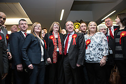 © Licensed to London News Pictures . 13/02/2014 . Manchester , UK . Labour's Mike Kane celebrates with his wife Sandra and Labour supporters . The count for the Wythenshawe and Sale East by-election , at Manchester Central this evening . Photo credit : Joel Goodman/LNP