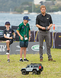 The Duke of Sussex drives a remote control car at the Invictus Games Jaguar Land Rover Driving Challenge, on Cockatoo Island, Sydney, on the fifth day of the royal couple's visit to Australia.